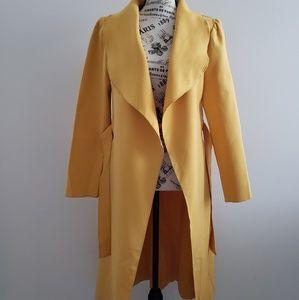 Trendy ruffled lapel mustard trench coat